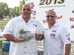 Jorge Arellano of Ocala Gran Prix receives his second straight U.S. Rotax Dealer of the Year award from Richard Bosclair
