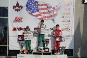 Michael d'Orlando atop the Mini Max podium (Photo: Ken Johnson - Studio52.us)
