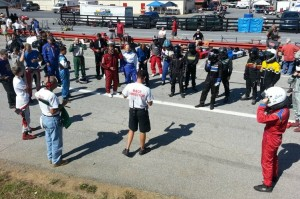 Race Director Brandon Taylor hosts a gathering of racers for the Saturday Race 1 drivers meeting (Photo: NCRM)