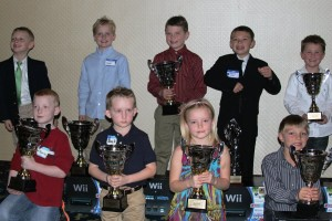 Kid Kart class champions pose with their trophies and Nintendo Wii prizes (Photo: Joe Brittin)