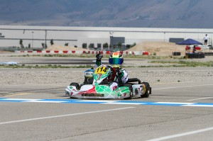 Dylan Tavella secured the 2014 US Rotax Mini Max National title with a bold last lap pass (Photo credit: Ken Johnson - studio52.us)
