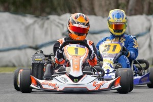 Mathew Kinsman (#1 orange kart) from brother Daniel Kinsman (#31) in Logitech 125cc Rotax Max Light (Photo: Fast Company/Graham Hughes)
