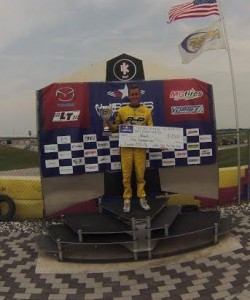 AJ Meyers of Checkered Motorsports atop the champions podium (Photo: Checkered Motorsports)