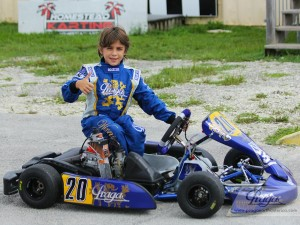 The young driver poses with his new Praga Piccolo chassis