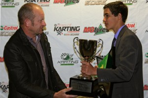 Jayden Ojeda accepting the Jon Targett Perpetual Trophy from Jon Targett (Pic: Coopers Photography)