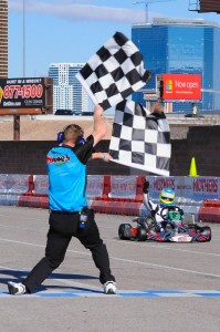 Christchurch karter Matthew Hamilton (#9NZ blue and yellow helmet ) greets the chequered flag to win the S4 Masters Stock Moto class at the 17th annual SKUSA SuperNationals meeting in Las Vegas last year (Photo: Fast Company/Ash Budd)