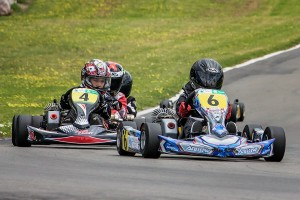 Euan Dwyer (#6) and Tom Bewley (#4) are close in a Cadet ROK class race on Sunday (Photo: Fast Company/Vicky Jack)