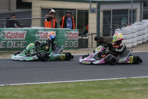 Jason Pringle (#35) congratulating Jake Klarich (#95) on his win in KZ2. (Pic: Coopers Photography)