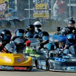 Junior 3 #00-Cole Neibert tries to get around the #73 on the outside (Photo: Bruce C. Walls/Action Sports Photos)