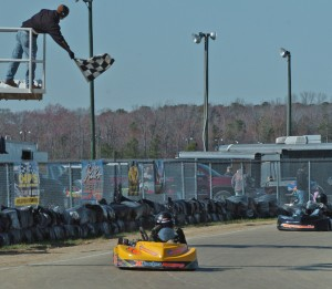 Adam Beville takes Clone Heavy's checkered flag (Photo: Bruce C. Walls/Action Sports Photos)