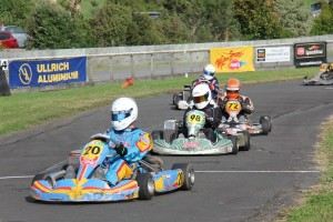 Rhys Tinney (#20) leads Danjela Haigh (#98) and Aarron Cunningham (#72) in a 125cc Rotax Max Light heat race (Photo: Fast Company/Alice Addy)