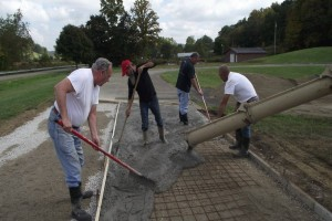 Many former and current karters pitched in to help with the resurfacing of Adkins Raceway Park