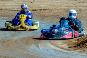 Scott Gaynor of Banning leading Lake Forest's Mike Collins in the So Cal Oval Karters Open main last Saturday at Perris Auto Speedway.  Collins eventually got by for the win with Gaynor placing second (Photo: Schnarzy)