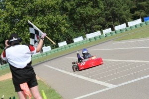 Kalb taking one of his three checkered flags during the Kershaw weekend (Photo: Double Vision Photography)