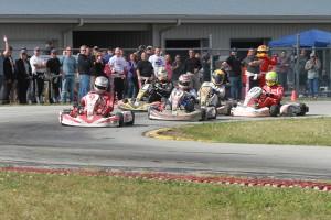 Scott Dixon completes last lap, last corner pass to win the Dan Wheldon Memorial ProAm Karting Challenge (Photo: EKN)