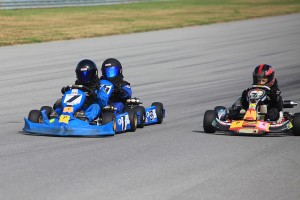 Zander Taylor (#7), Jace Park (#56) and Jake Duff (#24) ran 1-2-3 in the TaG Cadet category (Photo: Wright Tough Photography)