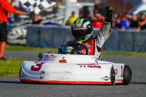 Hunter Fox with his fist held high after winning the 4 kart race to the line in Briggs Junior