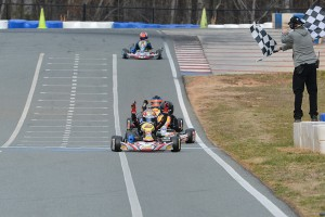 Caleb G crossing the line first at the WKA Winter Cup at the GoPro Motorplex