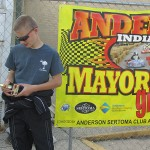 "Jordan Fresher checks out his first-ever street racing kart trophy in the ""Mayor's Cup Grand Prix"" victory lane in Anderson (IN) (Photo: Debbie Howe)"