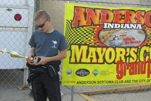 """Jordan Fresher checks out his first-ever street racing kart trophy in the """"Mayor's Cup Grand Prix"""" victory lane in Anderson (IN) (Photo: Debbie Howe)"""