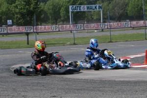 Josh Lane (44j) and Jason Alden (441) battle their way around the track in their Modena-powered karts.  (Photo: Susan Rothenhoefer)