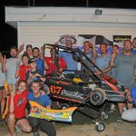 Team Austin Banker surrounded by crew, family and friends, after his fourth win