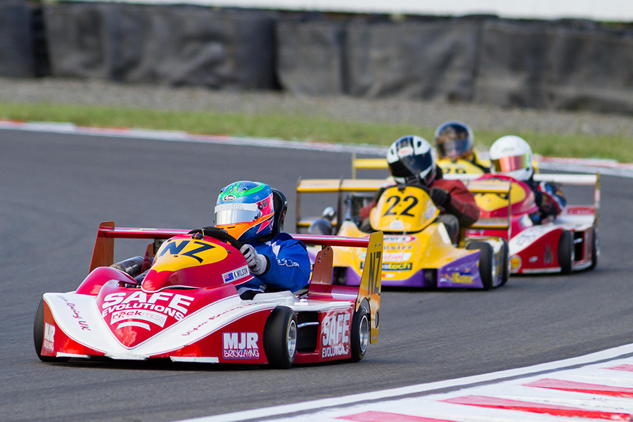 Wellington's Karl Wilson (#NZ) leading Paul Dunlop on his way to winning the 2014 New Zealand SuperKart Grand Prix at Taupo