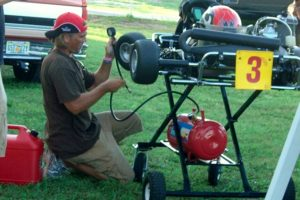 Oliver's father Tony working on his kart during the early years of karting
