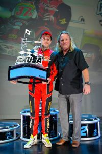 Formal with SKUSA CEO Tom Kutscher and the new 'Janowski' trophy for the S1 title (Photo: On Track Promotions - otp.ca)