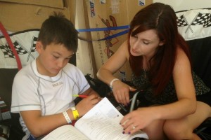 Nick completing school work between sessions with Trackside Tutoring's Brittany Doyle Lobaugh