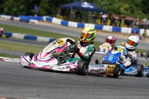 The outside line held for Jeremy Fletcher on the final lap to earn the X30 Junior victory (Photo: EKN)