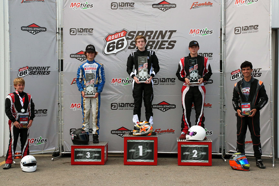 Matthew Miller on the P1 step for the Briggs 206 Junior podium both days at Autobahn